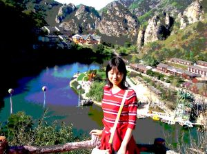 chines woman near a lake