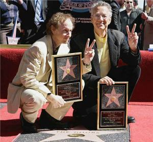 Robbie and Jim flash Peace and Victory as the Doors receive their Star.